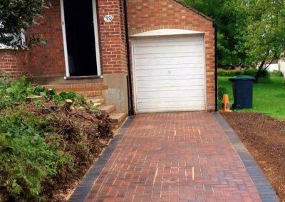 Block paving driveway leading to garage
