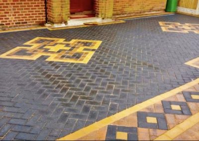 Block paving driveway with patterns