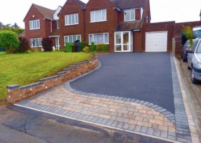 Block paving pattern with tarmac driveway