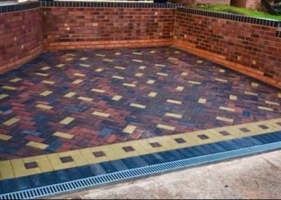 Block paving with wall