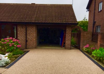 Driveway resin bound leading to garage