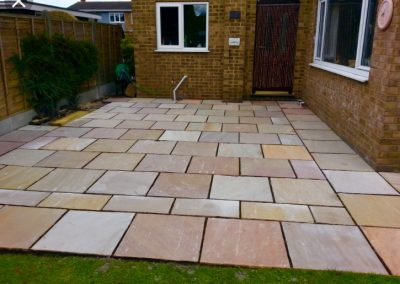 Garden area with sandstone paving
