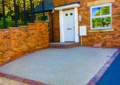 Light resin bound surface combined with brick border