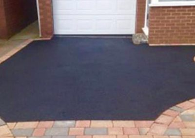 Mixture of tarmac driveway with block paving
