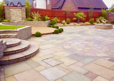 Patio with circle design Indian sandstone