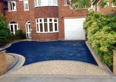 Pattern block paving edge with tarmac