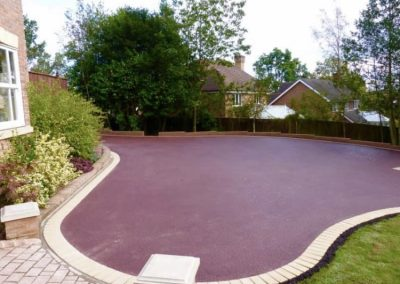Red tarmac driveway with brick edging