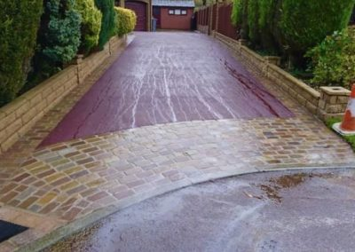 Red tarmac driveways installation