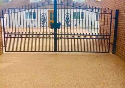 Resin Bound driveway with a brick border and gate