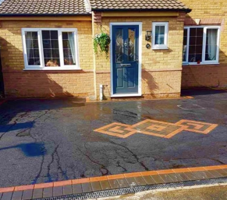 Patterned block paving with tarmac driveway